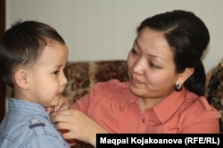 Dinara Qiyalova with her son, Abzal