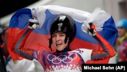 Skeleton racer Ylena Nikitina of Russia celebrates at the 2014 Sochi Olympics.