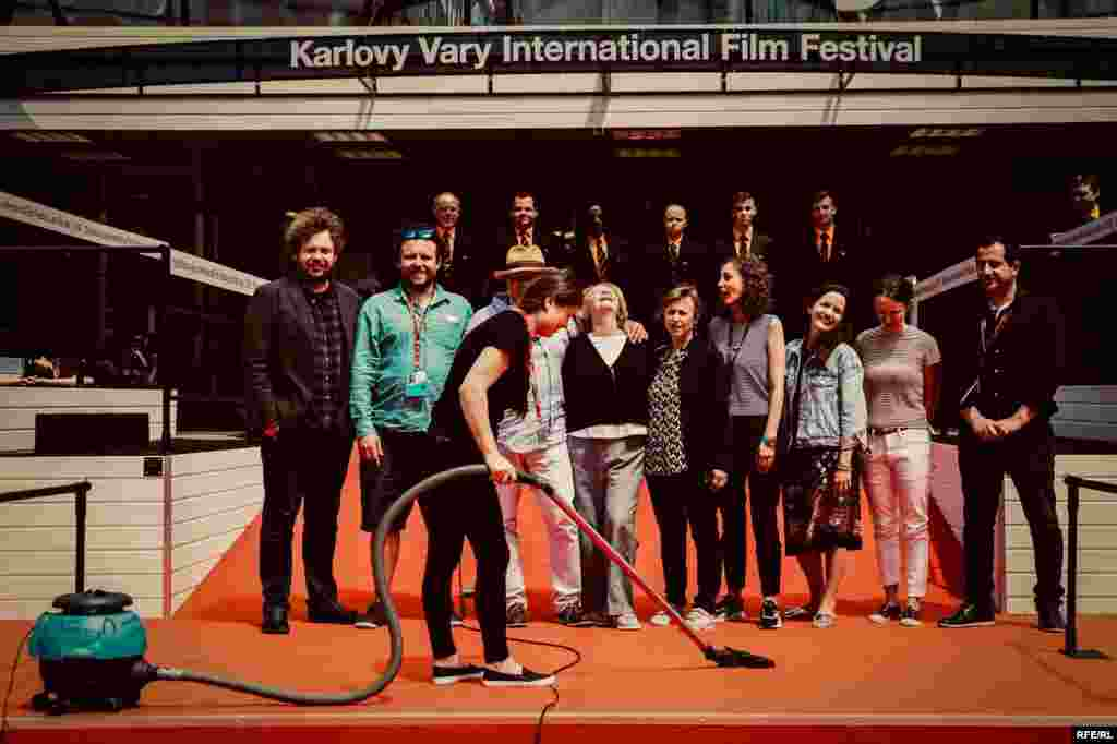 """Lights, Camera, Clean!"" Director Vitaly Mansky and his wife Natalia Manskaya pose with the Current Time team at the July 2018 Karlovy Vary International Film Festival, Czech Republic."