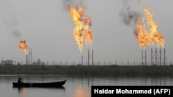 Fames rise from the burning of excess hydrocarbons at a natural gas field north of Basra.