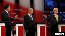 Republican presidential candidates (left to right) Mitt Romney, Ron Paul, and Newt Gingrich participate in a Republican presidential-candidate debate in Concord, New Hampshire, on January 8.