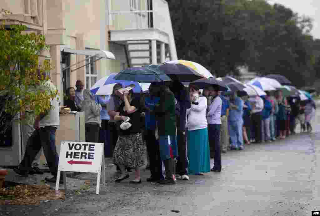 Voters wait in the rain in St. Petersburg, Florida.