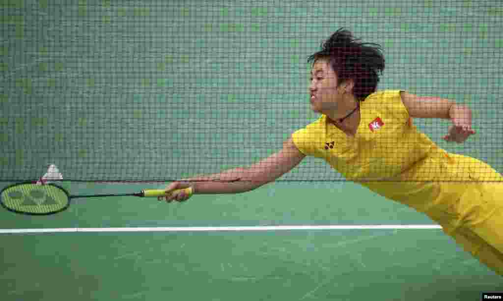 Yip Pui Yin of Hong Kong reaches for a shot during women's singles badminton group play against Kati Tolmoff of Estonia.