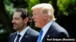 U.S. President Donald Trump (right) and then-Lebanese Prime Minister Saad Hariri hold a joint news conference after their meeting at the White House in Washington on July 25.
