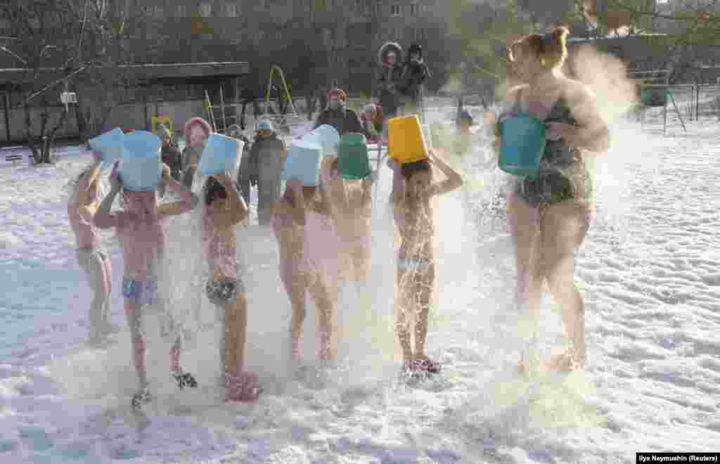 A fitness coach and her young students pour cold water on themselves as outside temperatures sank to minus 23 degrees Celsius (minus 9 degrees Fahrenheit), in Krasnoyarsk, Russia, on February 5.