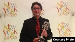 Radio Farda reporter Vahid Pourostad after receiving the New York Festivals' Silver Award, 17Jul2013.