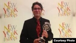 Radio Farda reporter Vahid Pourostad after receiving the New York Festivals' Silver Award, 17Jul2013.
