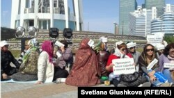 Some of those demonstrating at the Baitarek in downtown Astana on May 27 in favor of government intervention amid mounting foreclosures.