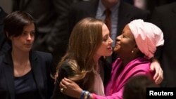 UN High Commissioner for Refugees (UNHCR) special envoy actress Angelina Jolie (center) greets UN Special Representative of the Secretary-General on Sexual Violence in Conflict Zainab Bangura before a United Nations Security Council session on June 24.