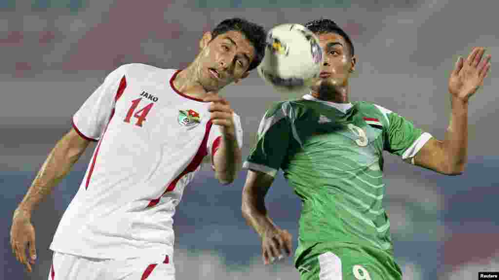 Iraq's Ahmed Gheni (right) challenges Jordan's Abdullah Salem during their West Asian Football Federation Championship soccer match in Kuwait City. (Reuters)