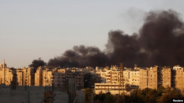 Heavy smoke covers the skyline of Aleppo after a bombing run by Syrian aircraft on September 24.
