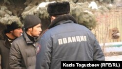 Two of the Uzbek asylum seekers wait outside the Almaty administrative court during their trial in January 2011.
