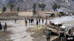 Paramilitary soldiers inspect the site of a bomb explosion in the Khyber tribal region, March 3, 2014.