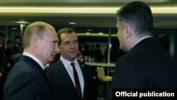 Russia - President Vladimir Putin and Prime Minister Dmitry Medvedev talk to Armenian Prime Minister Tigran Sarkisian, Sochi, 23Feb2014.