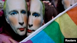 Protesters wearing masks of Russian President Vladimir Putin wearing makeup pretend to kiss as they take part in a demonstration against what they see as Rusian laws that discriminate against the LGBT community outside the Russian Embassy in London in 2014.