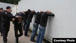 Полицейский рейд против мигрантов в Москве. Иллюстративное фото