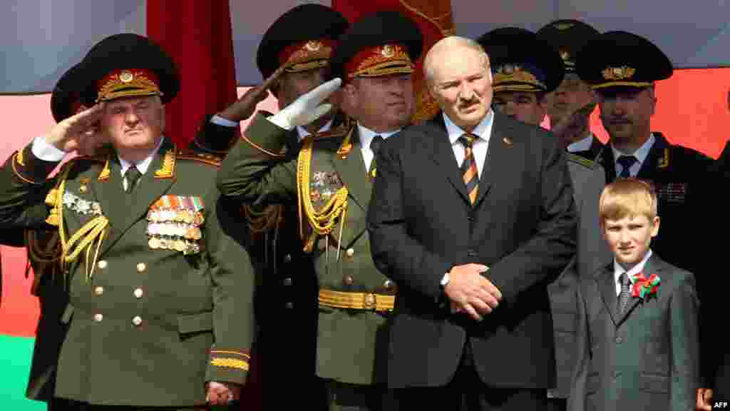 Lukashenka and Kolya watch a military parade to mark the nation's Independence Day in central Minsk in July 2012.