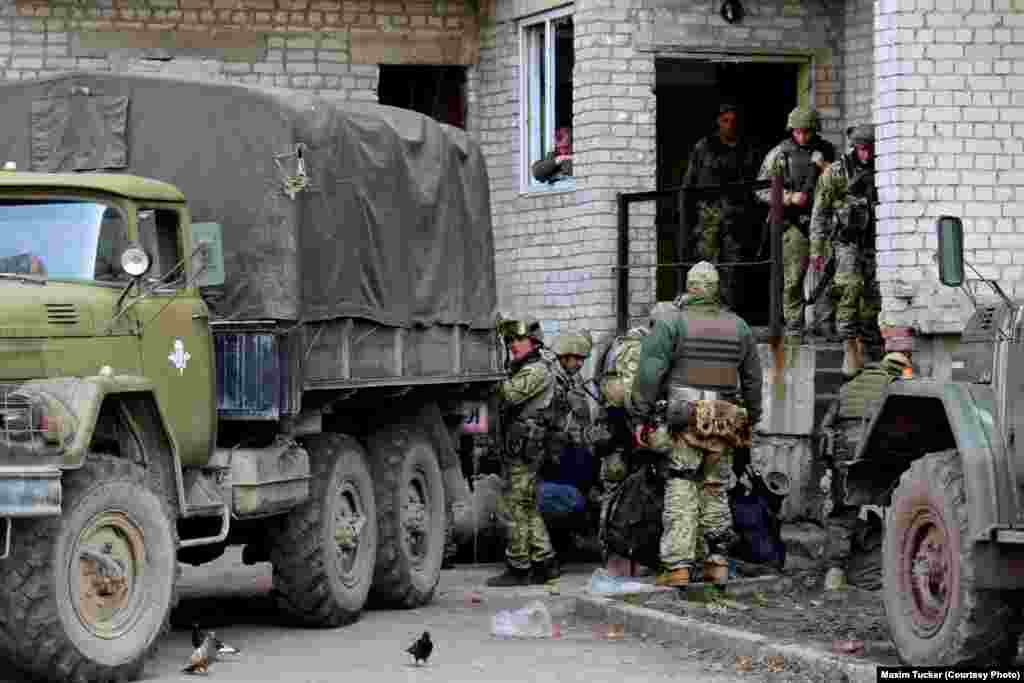 Ukrainian soldiers prepare to board an army truck heading for the front lines in Avdiyivka's industrial area, where the heaviest fighting is taking place. The Ukrainian Army has imposed a lockdown on the area, preventing all civilian access. April 7, 2016