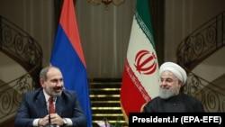 IRAN -- Armenian Prime Minister Nikol Pashinian meets with Iranian President Hassan Rohani at the Saadabad Palace in Tehran, February 27, 2019