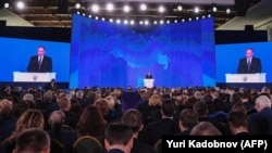 Russian President Vladimir Putin addresses the Federal Assembly at Moscow's Manezh exhibition center on March 1.