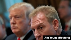 U.S. President Donald Trump, left, sits next to Acting U.S. Defense Secretary Patrick Shanahan during a Cabinet meeting at the White House on January 2.