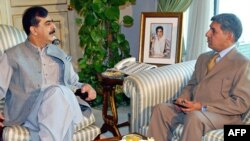 Pakistani Prime Minister Yousuf Raza Gilani (left) meets with ISI Director-General Ahmed Shuja Pasha in Islamabad in December.