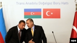 Azerbaijani President Ilham Aliyev (left) and Turkish Prime Minister Tayyip Erdogan in a June 2012 meeting at a Trans-Anatolian Natural Gas Pipeline Project signing ceremony in Istanbul.