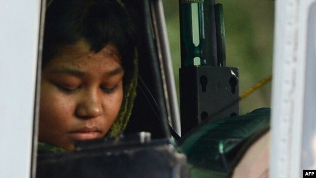Rimsha Masih, a disabled Pakistani Christian girl accused of insulting Islam sits in a  helicopter after her release from jail in Rawalpindi. She had been held on blasphemy charges for over a month until domestic and international condemnation prompted her release.