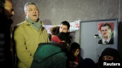 United Nations High Commissioner for Refugees Filippo Grandi visits a shelter for displaced Syrians in Jibreen, on the outskirts of Aleppo, on February 1.