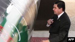 Turkmenistan President Gurbanguly Berdymukhammedov, seen here signing the East-West gas trunk pipeline in Shatlyk in May 2010, was reelected to a second term earlier this month.