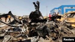 آثار إنفجار سيارة مففخة في بغداد 13/5/2014