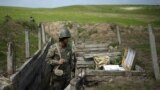 An ethnic Armenian soldier stands guard in a trench at artillery positions near the border with Nagorno-Karabakh (file photo from 2016)