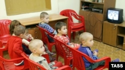 Orphans watch TV in an orphanage in Kostroma, northeast of Moscow.