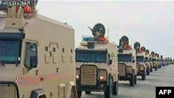 A contingent of Persian Gulf troops arrive in Bahrain across a causeway from Saudi Arabia on March 14.
