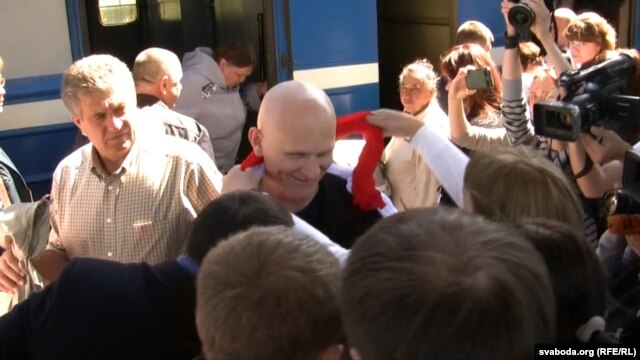 Ales Byalyatski is greeted by supporters at Minsk railway station.