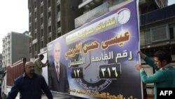 Багдадда шийилердин Даава партисынын үгүт плакатын орнотуу учуру. 14-февраль, 2010-ж.