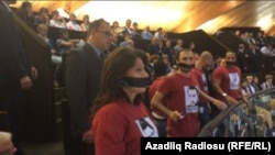 France -- PACE. activists protest Ilham Aliyev during his speech in Strasbourgh, 24 June 2014.