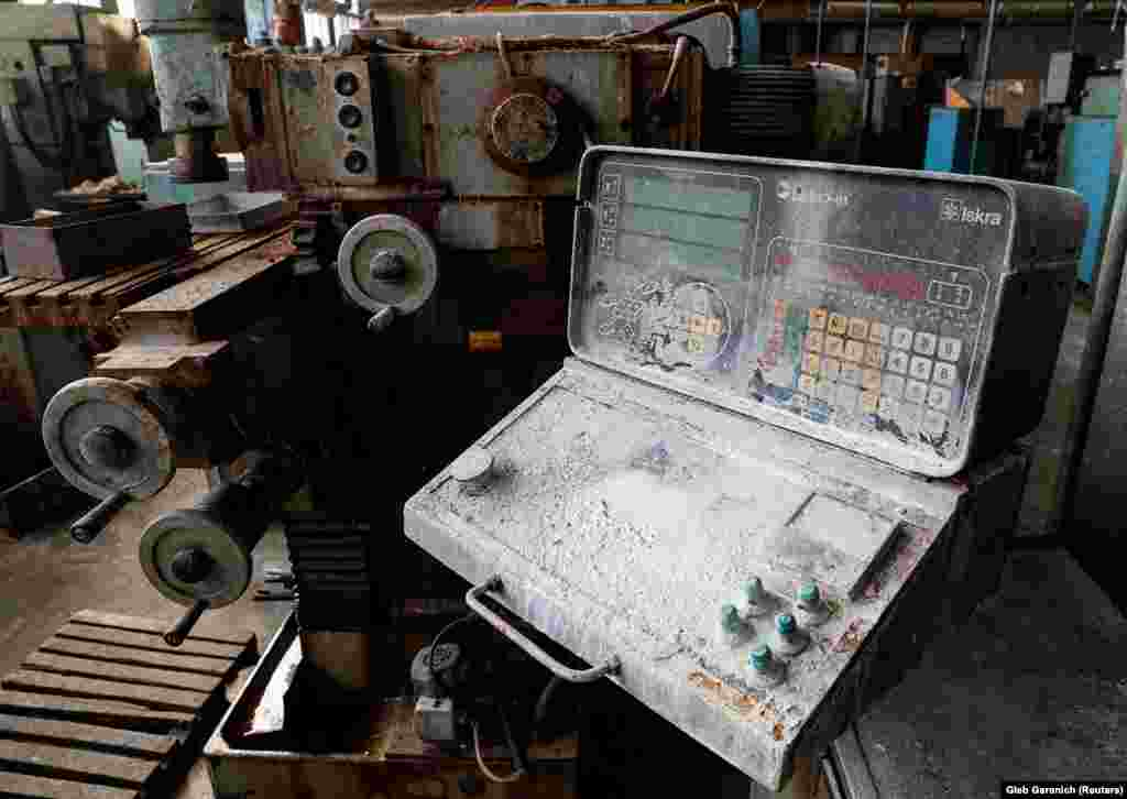 Rusting, dust-covered equipment sits abandoned inside the factory.  Eventually officials tracked down a man who knew where printouts for the designs were kept. He was working in a local supermarket.