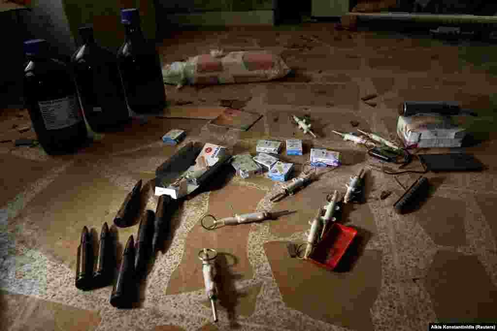 Materials for bomb making on the floor of the compound. The extremist group is known for leaving behind booby traps as they retreat.