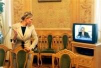 Yulia Tymoshenko watching Yushchenko deliver the speech in which he explained his decision to dismiss her on September 8, 2005 (AFP)