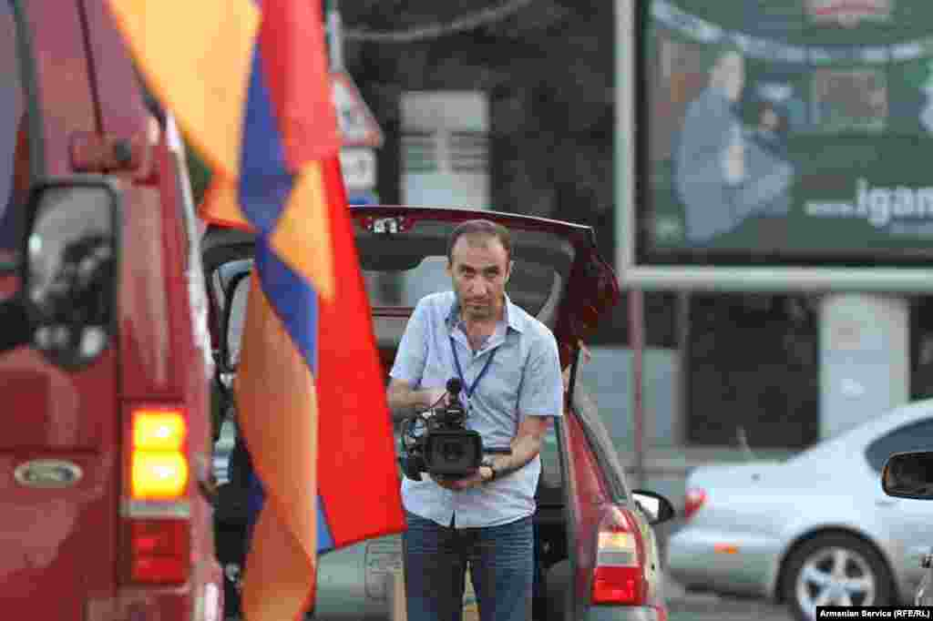 Armenia -- RFE/RL journalist at work in Yerevan, undated. RFE/RL journalists were among those beaten and detained while covering demonstrations in the capital in June 2015.