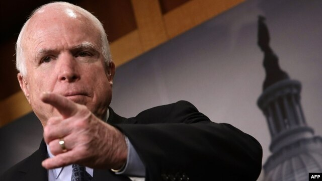 """U.S. Senator John McCain is among those who are unhappy with the new U.S. spending bill, which he says panders to """"[Russian President] Vladimir Putin and his gang of thugs."""" (file photo)"""