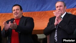 Armenia - Former President Levon Ter-Petrosian (R) and Prosperous Armenia Party leader Gagik Tsarukian greet supporters rallying in Yerevan's Liberty Square, 10Oct2014.