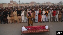 People gather to offer funeral prayers by the body of a Pakistani prisoner executed in January 2015. Pakistan lifted a six-year moratorium on the death penalty after militants killed more than 150 people at a school in the northwestern city of Peshawar in December 2014.