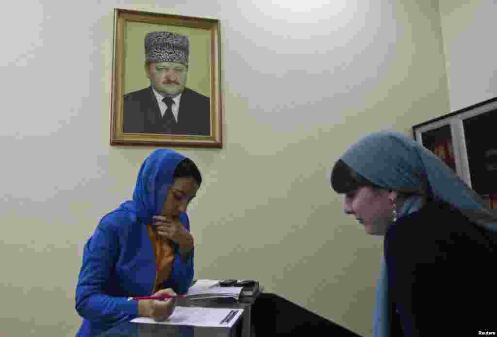A worker signs documents at a memorial complex devoted to late President Akhmad Kadyrov.