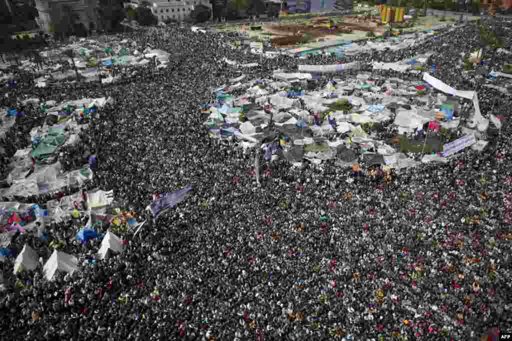 Antigoverment demonstrators flood Tahrir Square on February 11, 2011.