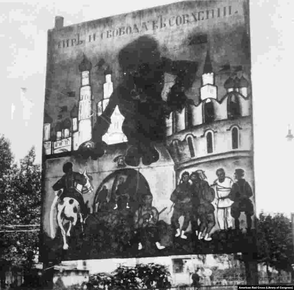 """A White Army propaganda poster on display in Kharkiv depicting a cloven-footed Leon Trotsky, the Bolshevik army commander. One White Army general called on Russians to destroy """"the evil force which lives in the heart of Jew-communists."""""""