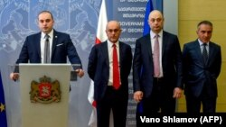 Georgian Prime Minister Mamuka Bakhtadze speaks to reporters on July 12 as he introduces new cabinet members in Tbilisi, including Education Minister Mikheil Batiashvili (right), Economy Minister Giorgi Kobulia (second right) and Finance Minister Vano Machavariani (third right).