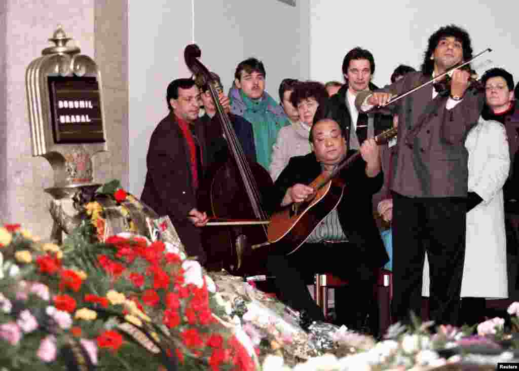A Romany band plays at Hrabal's funeral in a Prague crematorium 1997. Hrabal died on February 2, 1997 after falling from a Prague hospital window. He was apparently trying to feed some pigeons.