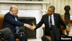 أوباما يصافح العبادي في البيت الأبيض - 14 نيسان 2015